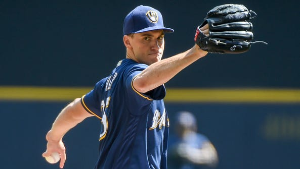 Milwaukee Brewers pitcher Brent Suter (35) throws a