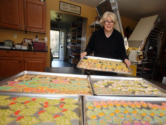Christine Suhre-Garza unloads a tray of holiday cookies, while in the kitchen of her Poughquag home Nov. 15, 2017.