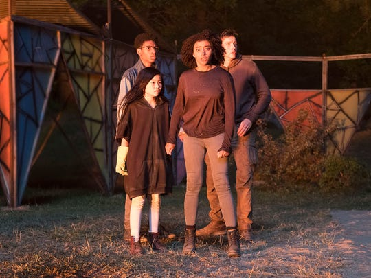 """Skylan Brooks (back left), Miya Cech, Amandla Stenberg and Harris Dickinson are teens with special abilities on the run from the government in """"The Darkest Minds."""""""