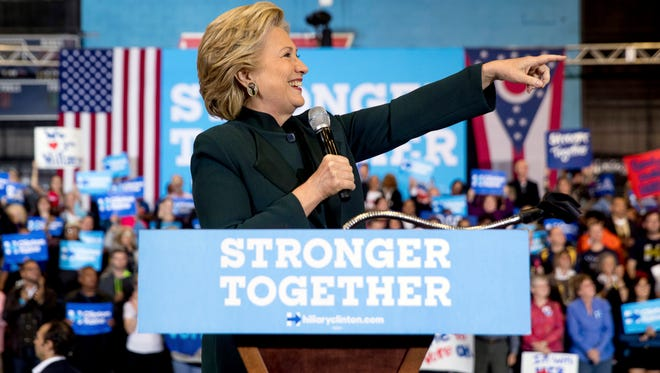 Democratic presidential candidate Hillary Clinton points to the crowd while speaking at a rally at Cuyahoga Community College in Cleveland, Friday, Oct. 21, 2016. (AP Photo/Andrew Harnik)
