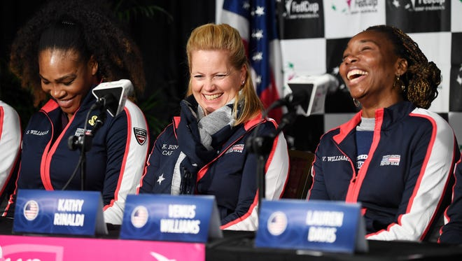 From left, Serena Williams, US Team Captain Kathy Rinaldi and Venus Williams laugh during a press conference following the Fed Cup match draw at the US Cellular Center February 9, 2018.