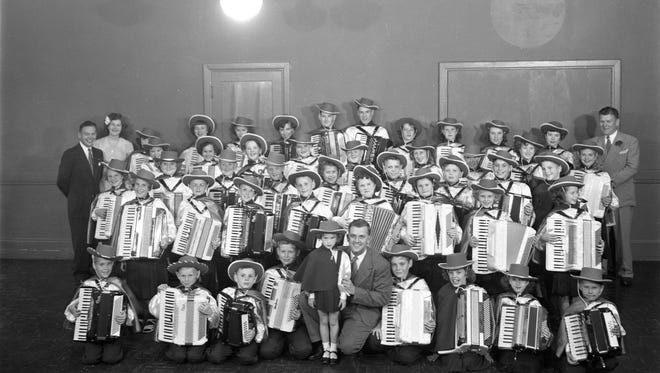 Accordion playing was popular with kids in the 1950s. Shown here are Kitsap County accordion students and instructors along with local TV personality Stan Boreson, front row center, and police chief Art Morken, back row right. Boreson's afternoon children's show on KING-TV featured accordion playing, skits and Stan's basset hound. To see more photos from the Kitsap County Historical Society Museum archives, visit facebook.com/kitsaphistory, kitsapmuseum.org, or stop by the museum at 280 Fourth Street in Bremerton. Call 360-479-6226 for information.