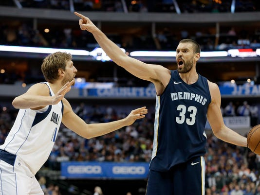 Dallas Mavericks' Dirk Nowitzki (41) of Germany defends as Memphis Grizzlies' Marc Gasol (33) directs the offense in the first half of an NBA basketball game, Wednesday, Oct. 25, 2017, in Dallas. (AP Photo/Tony Gutierrez)