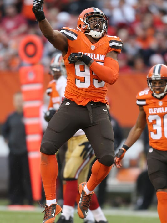FILE - In this Sunday, Dec. 13, 2015, file photo, Cleveland Browns defensive end Armonty Bryant (95) celebrates after sacking San Francisco 49ers quarterback Blaine Gabbert (2) during the second half of an NFL football game, in Cleveland. Bryant will not play in the game at Kansas City on Sunday, Dec. 27, 2015, after he and safety De'Ante Saunders were arrested Christmas morning following a traffic stop. Bryant, who has a history of legal troubles, is not traveling with the team so he can tend to the legal matter. Browns general manager Ray Farmer issued a statement on Saturday condemning the players' behavior. (AP Photo/Ron Schwane, File)