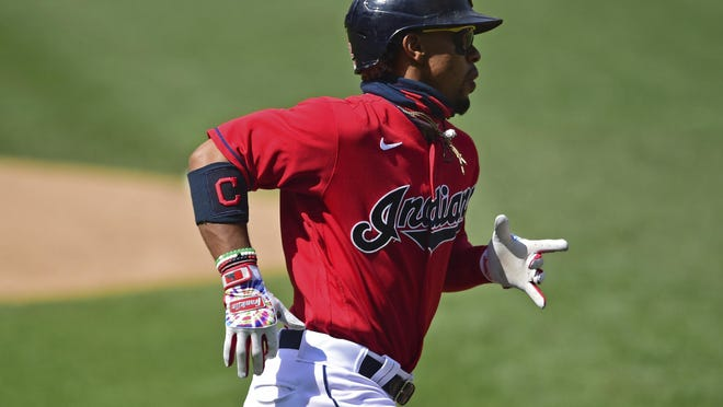 The Indians' Francisco Lindor runs to first base after hitting a single during the fourth inning against the Milwaukee Brewers on Sunday.