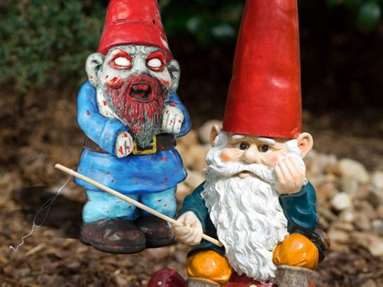A zombie gnome approaches a peaceful fishing gnome.