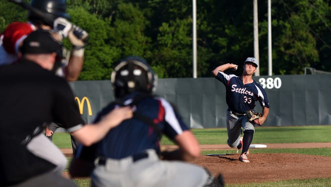 Licking Valley graduate Craig Prince pitches for the Licking County Settlers against the Lorain county Ironmen during their Great Lakes Summer Collegiate League opener on Thursday, June 8, 2017. The Settlers won 11-10.