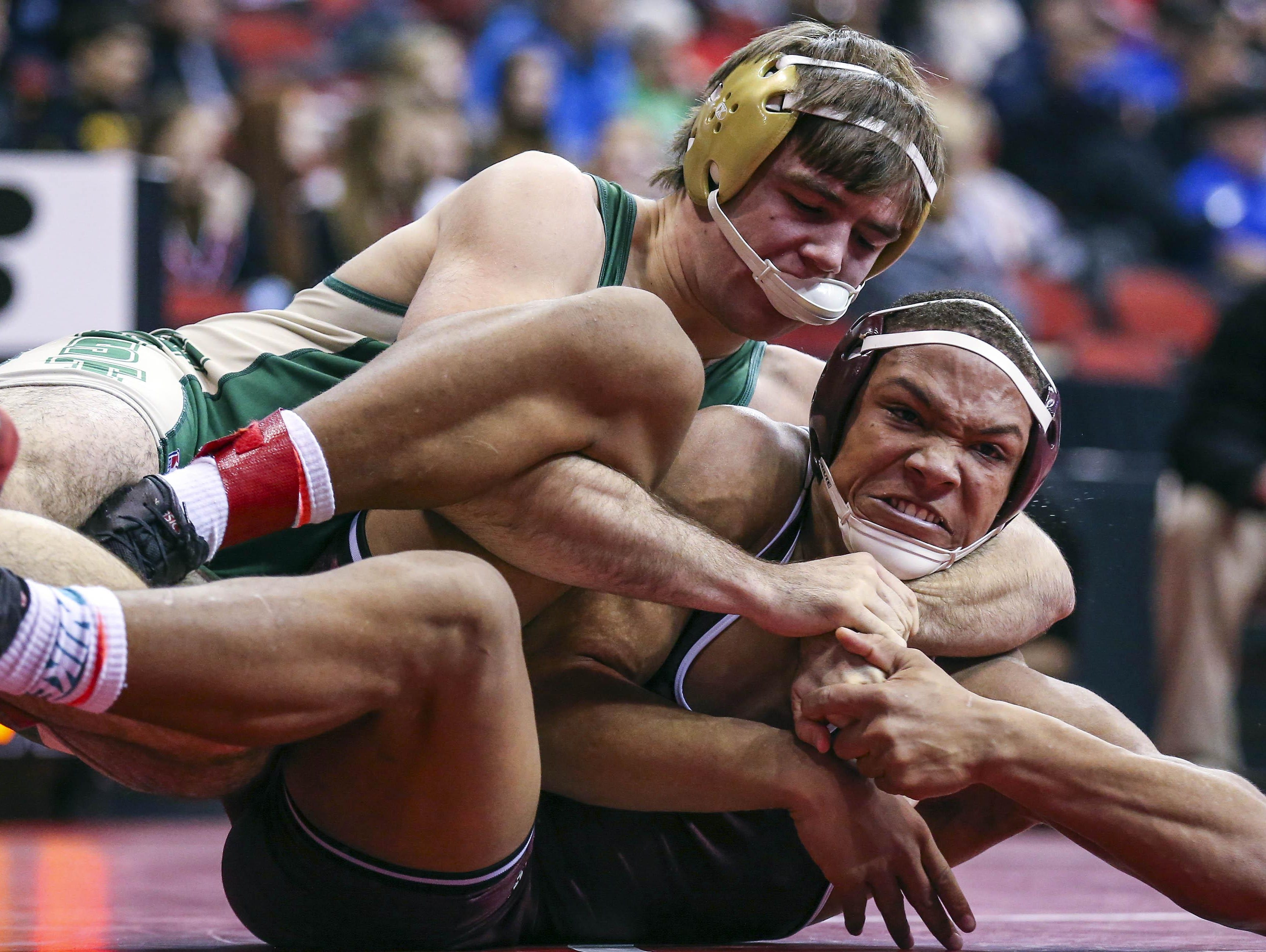Iowa City West's Donovan Doyle, top, wrestles Dowling's Jacob Zachary during a Class 3A first-round match at the state tournament last season. Doyle is the Trojans' top wrestler returning.