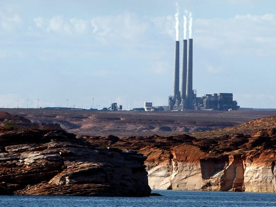 *FILE - This Sept. 4, 2011 file photo shows the main plant facility at the Navajo Generating Station northeast of Grand Canyon National Park as seen from Lake Powell in Page, Ariz. A new study concludes visitors may be steering clear of some U.S. national parks or cutting their visits short because of pollution. (AP Photo/Ross D. Franklin, File)