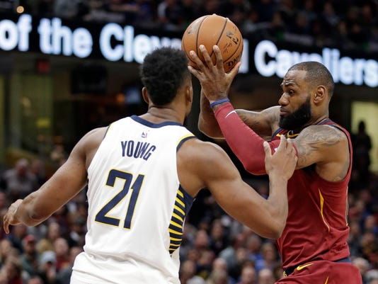 Cleveland Cavaliers' LeBron James, right, drives against Indiana Pacers' Thaddeus Young in the first half of an NBA basketball game, Wednesday, Nov. 1, 2017, in Cleveland. (AP Photo/Tony Dejak)