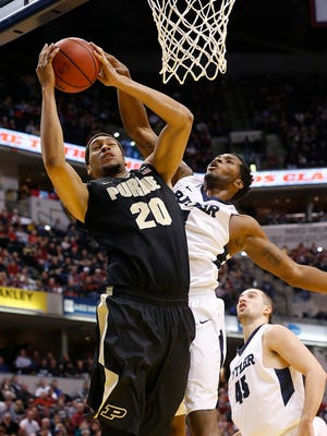 Purdue Boilermakers center A.J. Hammons (20) pulls down a rebound during the Crossroads Classic at Bankers Life Fieldhouse on Dec. 19, 2015.