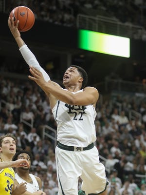 Michigan State forward Miles Bridges scores against Michigan forward Mark Donnal in the second half Sunday, Jan. 29, 2017 at the Breslin Center in East Lansing.