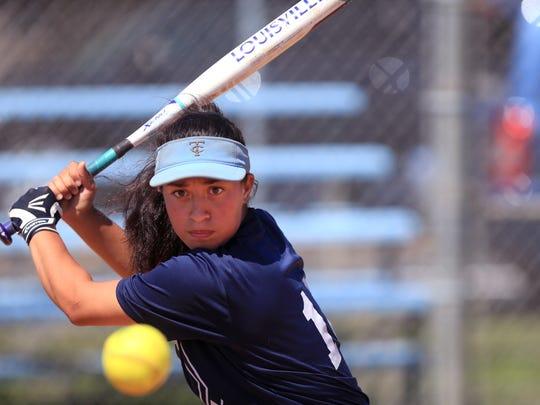 Carroll High School softball player Olga Zamarripa participates in batting practice on Monday, April 25, 2017.