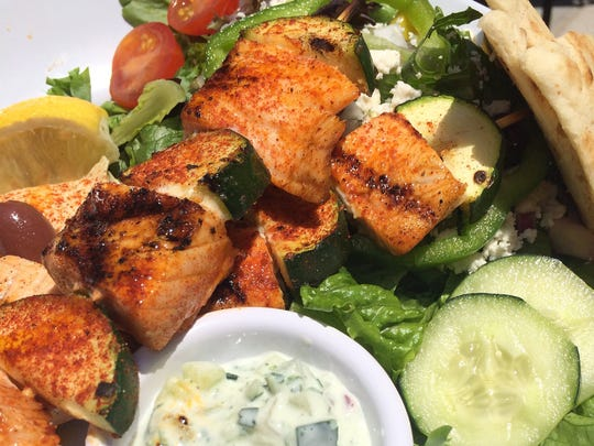 A salmon kabob at Zoes Kitchen is served with a side