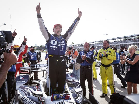 Graham Rahal raises his arms up as he celebrates winning the IndyCar Dual II race during the third day of the Detroit Grand Prix at Belle Isle Park, Sunday, June 4, 2017 in Detroit.