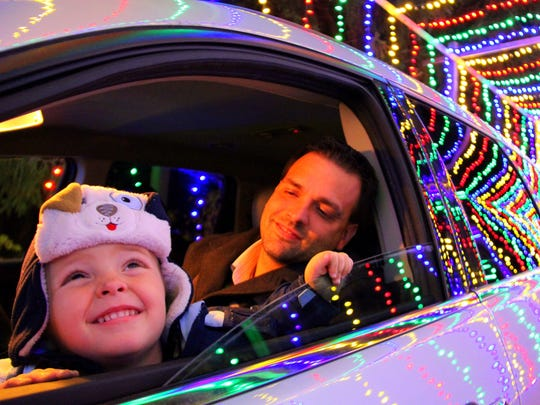 A child enjoys The Tunnel of lights at Wisconsin Christmas Carnival of Lights displayed at Jellystone Park Camp-Resort in Caledonia.
