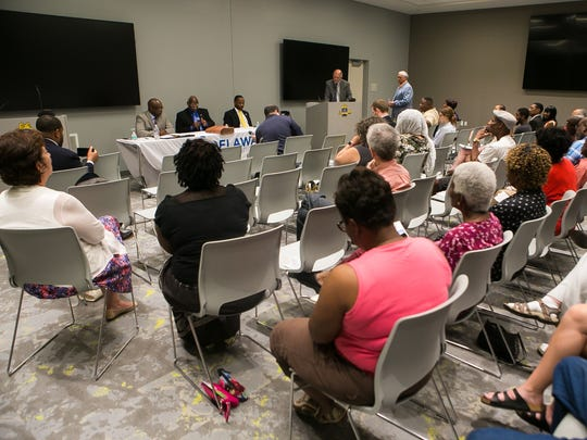 Delaware's Democratic candidates for Senate District 2, Bobby Cummings, Sam Guy and Darius J. Brown hold a public debate at the Route 9 Library and Innovation Center in New Castle.