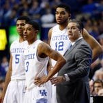 Kentucky Wildcats head coach John Calipari reacts in the huddle with guard Tyler Ulis (3), guard Andrew Harrison (5) and forward Karl-Anthony Towns against Vanderbilt.