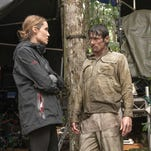 """In this image released by Universal Pictures, director Angelina Jolie, left, and actor Jack O'Connell appear on the set of """"Unbroken."""""""