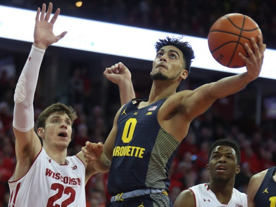 Marquette's Markus Howard drives to the basket against