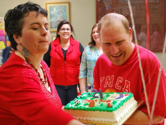 Alongside friends and family, Rodney Clay celebrates 21 years working at San Angelo's YMCA on Wednesday, Feb. 14. Clay has autism, but the Y has helped him find his voice.