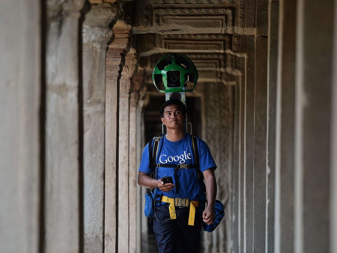 A technician carries a backpack device housing 15 cameras as he digitally maps the Angkor Wat temple on April 3 in northwestern Cambodia. Google has mapped Angkor Wat, allowing people to visit the famed temples from the comfort of their armchair using Google Street View.