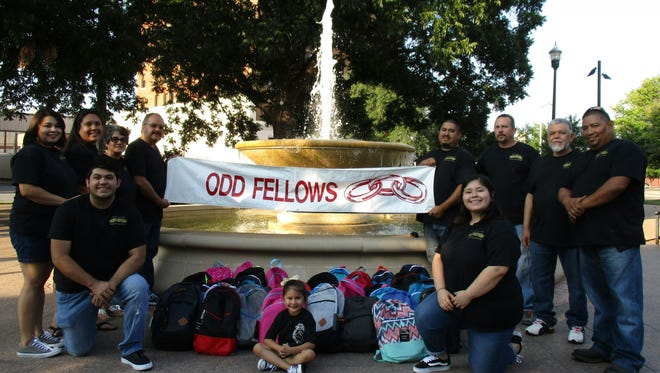 Abilene Lodge 325 of the Independent Order of Odd Fellows recently donated 45 backpacks filled with school supplies to help local children. Front row, from left: Joe Ramirez, Leandra Ramirez and Leanna Grimaldo. Back row: Crystal Ramirez, Rosa Mata, Martha Ramirez, Lee Ramirez Sr., Lee Ramirez Jr., Michael Sherman, Mario Rosales and Steve Galvan.