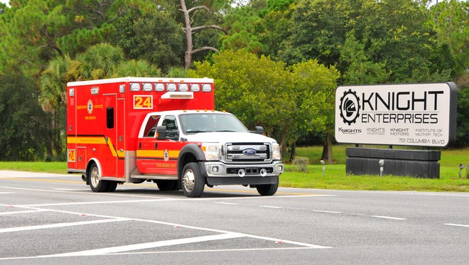 Firetrucks and ambulances leave Knight's Armament in Titusville after an early morning fire in a bunker.