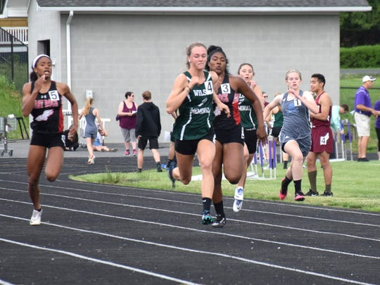 Wilson Memorial's Emilie Miller, center, leads during her heat of the 100-meter dash at a regular-season meet on Wednesday, May 9, 2018, at Waynesboro High School in Waynesboro, Va.