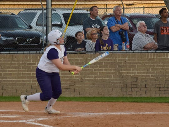 ASH's Briahna Bennett (3, left) watches the ball she hit sail out of the park in a 2015 game. Bennett is one of the Lady Trojans' top power hitters and is a part of their 1-2 pitching punch.