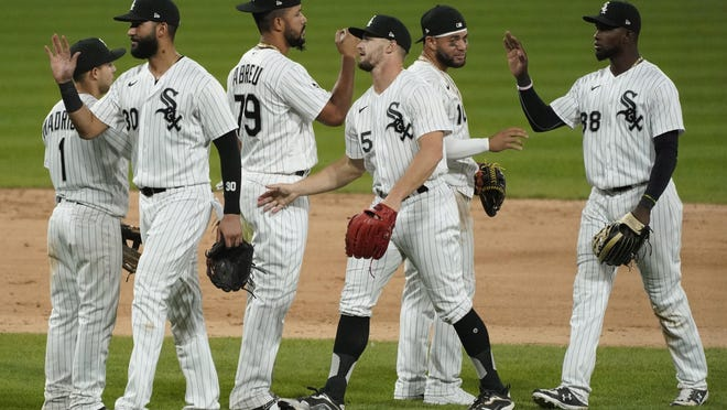Chicago White Sox players celebrate after the White Sox defeated the Chicago Cubs 9-5 on Saturday, Sept. 26, 2020.