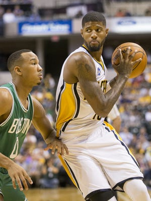 Paul George (right), works against Boston's C. J. Miles, second half of Boston Celtics at Indiana Pacers, Bankers Life Fieldhouse, Indianapolis, Wednesday, Nov. 4, 2015. Indiana won 100-98.