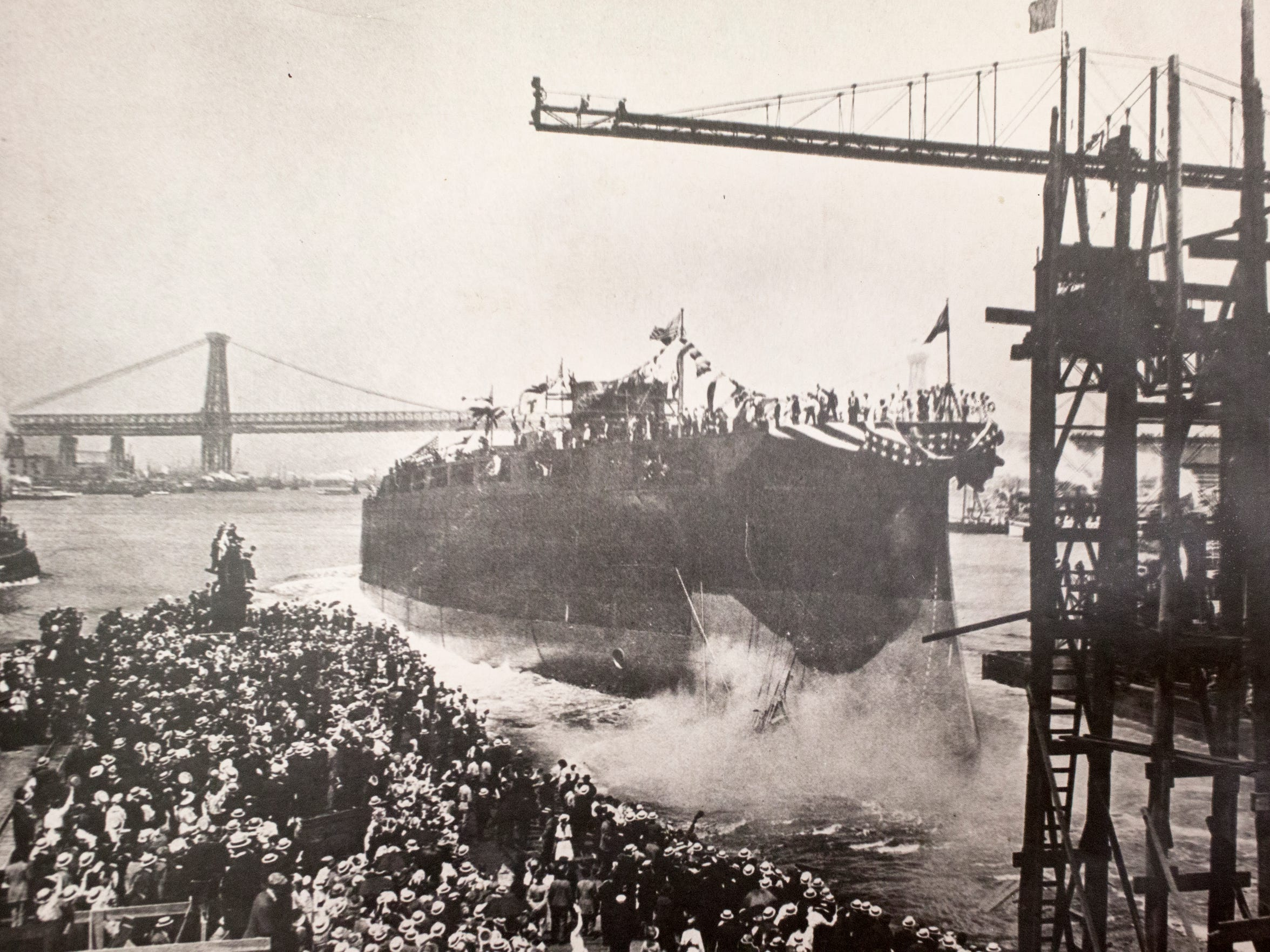 The USS Arizona is christened as a crowd watches June