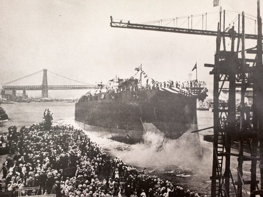 The USS Arizona is christened as a crowd watches June 19, 1915, at the Brooklyn Navy Yard.