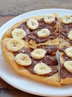 Izzy's nutella and banana dessert pizza
