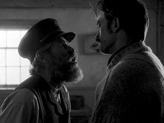 """Willem Dafoe, left, and Robert Pattinson in """"The Lighthouse."""""""