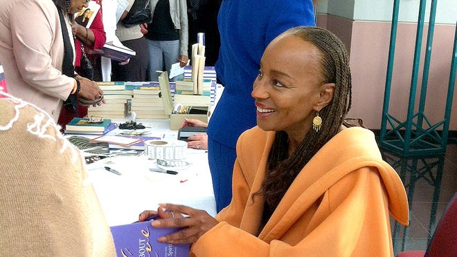 Susan L. Taylor greeted women and signed copies of her book following the YWCA luncheon.