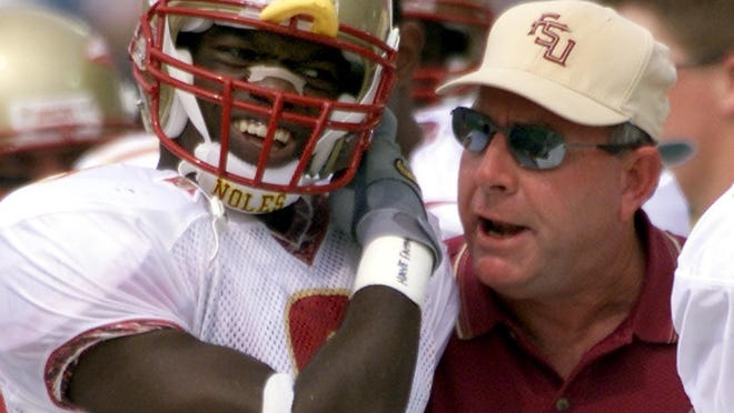 Former FSU defensive back Bryant McFadden hears some choice words from former defensive coordinator Mickey Andrews during a game.
