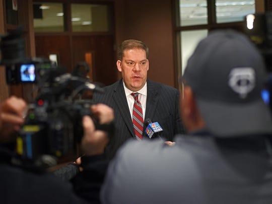 Minnehaha County State's Attorney Aaron McGowan speaks