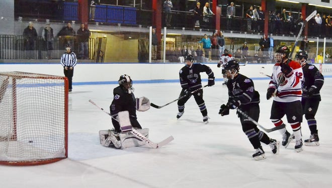 Rye forward Theo Bresolin watching his third-period shot trickle over the line and break a 5-5 tie. The Garnets went on beat John Jay 8-5 on Wednesday at Playland Ice Casino.