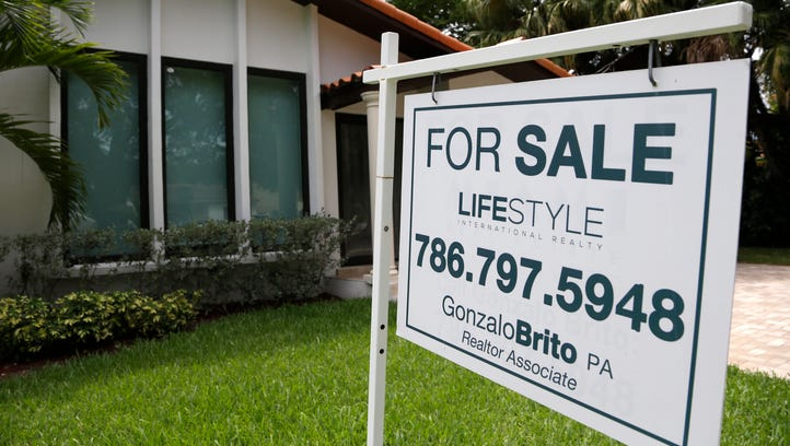 A for sale sign is placed in front of a home in Miami.