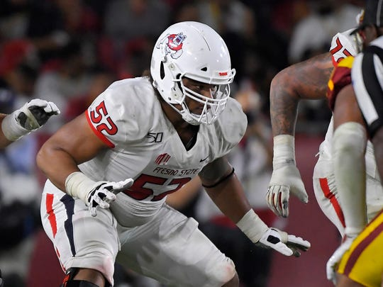 Fresno State offensive lineman Netane Muti runs a play during the second half of an NCAA college football game against Southern California Saturday, Aug. 31, 2019, in Los Angeles. USC won 31-23. (AP Photo/Mark J. Terrill)