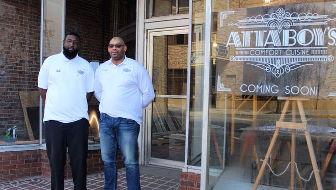 "Chris Rennick and Robert Turner stand outside of their restaurant ""Attaboy's"" that will serve a combination of Philadelphia and Memphis cuisines."