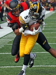 Iowa running back Damon Bullock picks up yards against Maryland in a 2014 game. He ran for 1,074 in his Hawkeye career. Bullock was struck by a vehicle and killed Sunday in Texas at age 25.