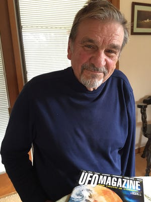 Harry Willnus, 78, of South Lyon talks to Jim Schaefer about the 50th anniversary of the Swamp Gas Case involving UFO sightings in March 1966 in Dexter and at Hillsdale College. Willnus is a UFO enthusiast who has researched the case, which made headlines all over Michigan back then. Photo taken in his home.