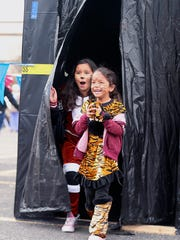 Trick-or-treaters Lea Aahola (right) and Bella Aahola react after walking through a haunted house during the Tom Green County Sheriff's Office's second annual Trunk or Treat Tuesday, Oct. 31, 2017.