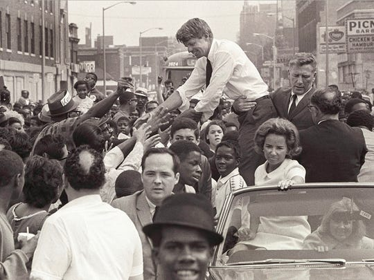 Sen. Robert Kennedy and his wife, Ethel, ride an open convertible in a motorcade through Detroit during his his May 15, 1968 visit to Detroit, the last time he visited Michigan before his assassination that June.