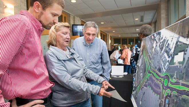 Pensacola Beach residents Donna and Howard Blair ask Seth Tibbs, of Volkert, left, questions about updated plans during a beach traffic meeting held at Our Lady of the Assumption Catholic Church in Pensacola on Monday, April 23, 2018.