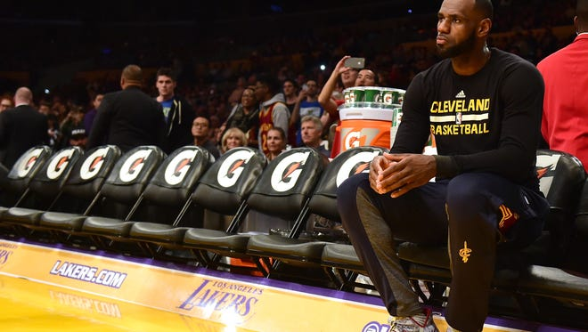 LeBron James, shown here before a game at the Lakers in March, has agreed to a four-year, $137 million contract with the Lakers.