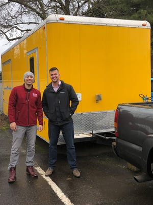Dimitri Fenrick (left) and Jesse Caldwell (right) stand in front of their new food cart, It's A Pasta. The cart should open at Beehive Station this April.